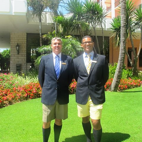 Bermudian hoteliers in their Bermuda shorts business attire