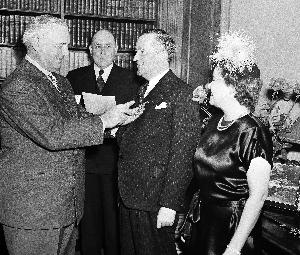 Sir William Stephenson receiving Medal for Merit